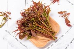 Fresh cedrela sinensis  on white wood background.
