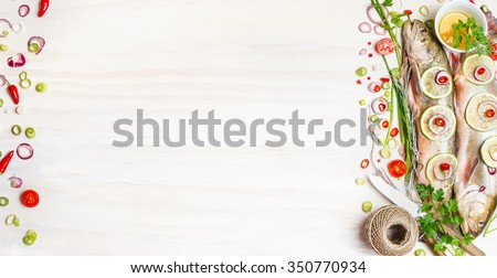 Fresh char fish with herbs, spices and ingredients for tasty cooking on white wooden background, top view, banner.  Healthy food or diet nutrition concept.