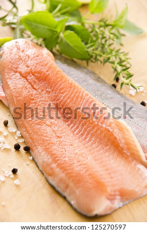 fresh char with herbs on the wooden plate