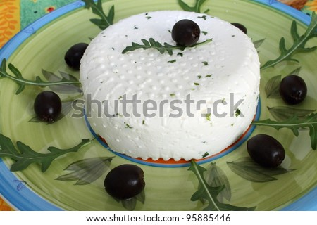 fresh cheese with black olives