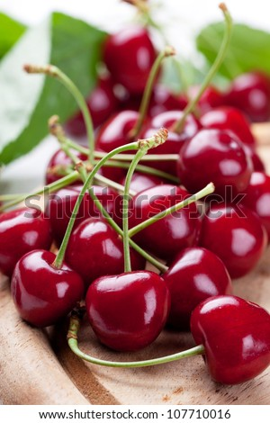 Fresh cherries on wooden board