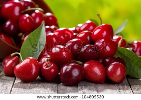 fresh cherries on wooden table