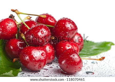 Fresh cherry berries with drops isolated on white