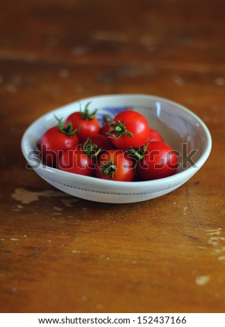 Fresh cherry tomato harvest or crop in a bowl