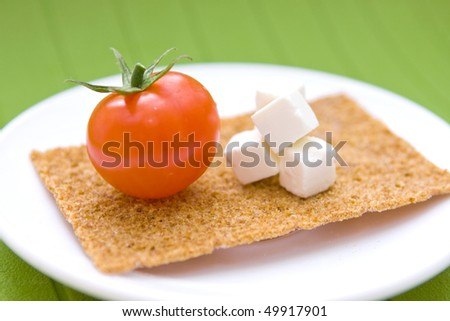 Fresh cherry tomatoes and greek cheese on plate