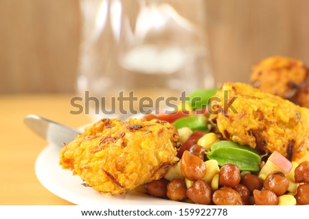 Fresh chickpeas on a plate with peaju