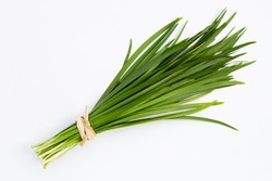 Fresh Chinese Chive leaves on white background.
