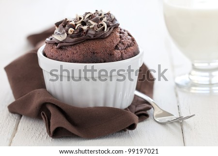 fresh chocolate muffin in a ramekin with fork