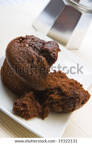 Fresh chocolate muffin on a white plate