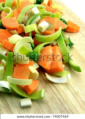 Fresh chopped vegetables on a chopping wooden board