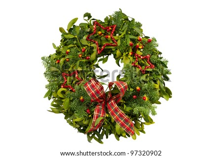Fresh Christmas wreath made of real fir and mistletoe boughs - stock photo