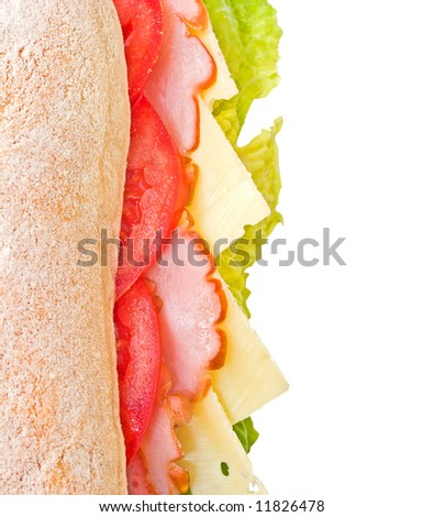 Fresh ciabatta sandwich with lettuce, ham, cheese and ripe tomatoes isolated on white