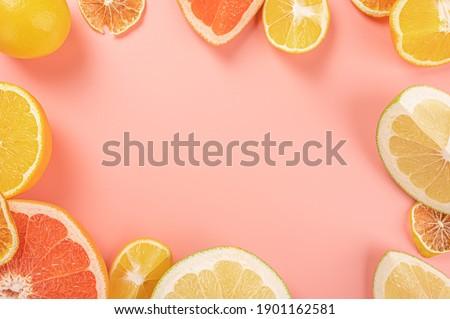 Fresh citrus fruit assortment. Different citrus fruit on pink background. Fruit food frame border. background with citrus fruits. Healthy eating and diet. copy space