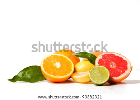 Fresh citrus fruit with leaves on a white board