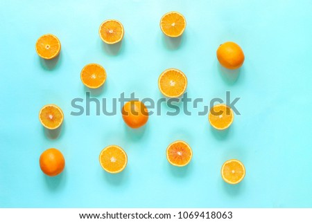 Fresh citrus fruits split on turquoise background. The view from the top. Summer, juicy background.