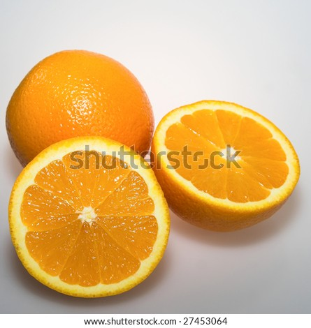 Fresh citrus oranges whole and sliced