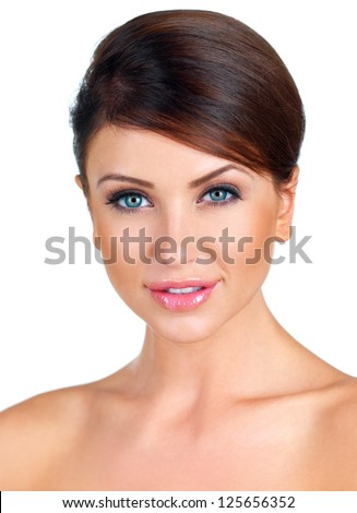 Fresh clean portrait of a beautiful woman with bare shoulders and her hair tied neatly back smiling charmingly at the camera isolated on white