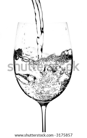 Fresh, clear water being poured in to a wine glass