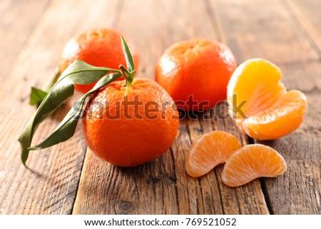 fresh clementine and leaf #769521052