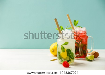 Fresh cocktail drinks with ice fruit and herb decoration. Alcoholic non-alcoholic drink-beverage. Mojito on blue background #1048367074