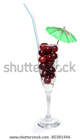 fresh cocktail from fresh cherries with an umbrella and tube on a white background