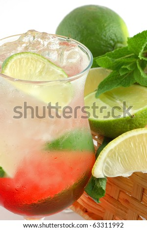 Fresh cocktail with a lime , mint and ice on a white background
