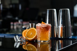 Fresh cocktail with orange and ice. Alcoholic, non-alcoholic drink-beverage at the bar counter in the night club.