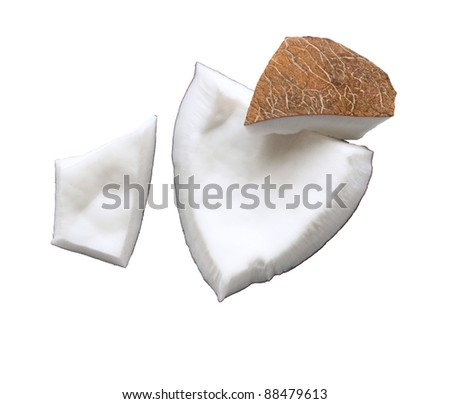 Fresh coconut flesh pieces broken isolated on white background
