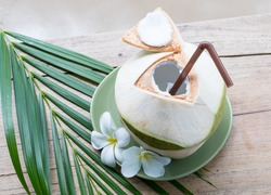 Fresh coconut on a wooden table