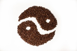 fresh coffee beans isolated and centered against a white backdrop in a yin yang shape representing balance in quality, taste, or mood.