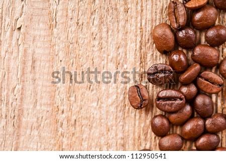 fresh coffee beans on rustic wooden board macro image