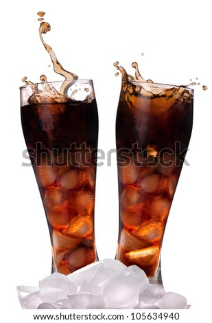 fresh Cola with ice cubes on a white background