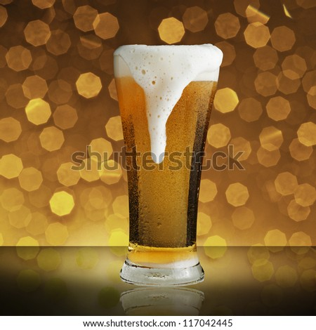 Fresh cold beer on beautiful bokeh background