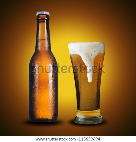 Fresh cold bottle and glass of beer on yellow background