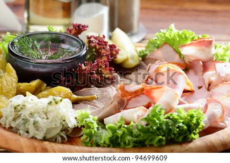 Fresh cold cuts on the wooden plate