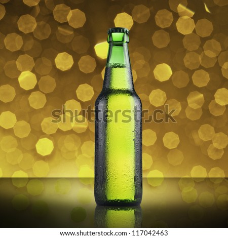 Fresh cold green beer bottle on beautiful bokeh background