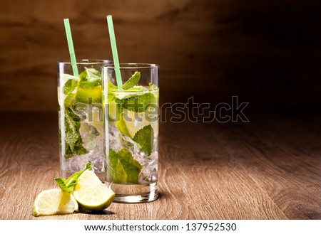Fresh cold Mojito Cocktail on a wooden background