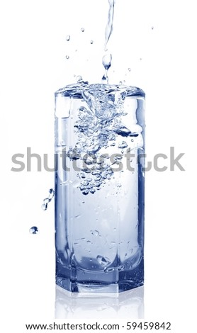 Fresh Cold Water Pouring Into Full Glass. Isolated on white background