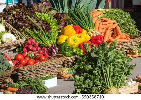 Fresh colorful vegetables for sale at a market #550358710