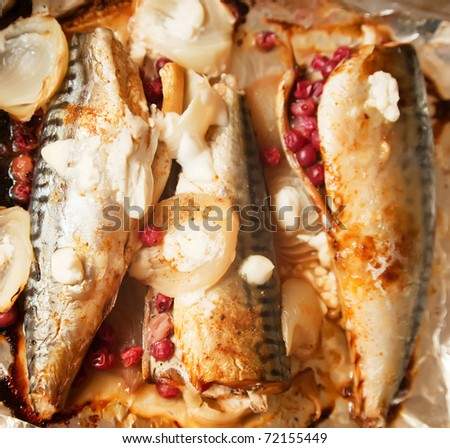 Fresh cooked mackerel with cranberry in foil   at kitchen