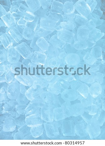 fresh cool ice cube background in blue light