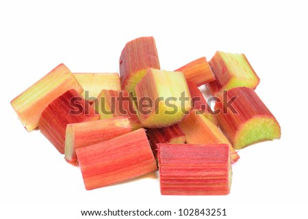 Fresh copped pieces of rhubarb on a white background