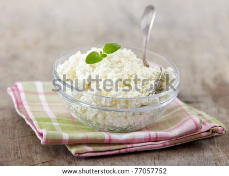 fresh cottage cheese on old wooden table - stock photo