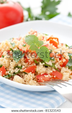 fresh couscous with tomato and parsley