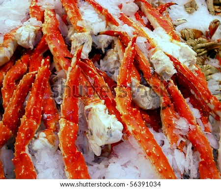 Fresh crab legs at a seafood market.