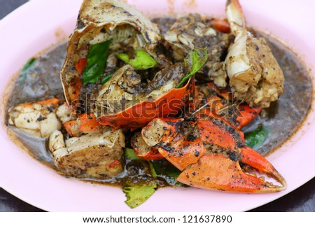 Fresh crabs cooked with black pepper sauce on plate