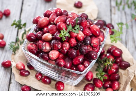 Fresh Cranberries on vintage wooden background