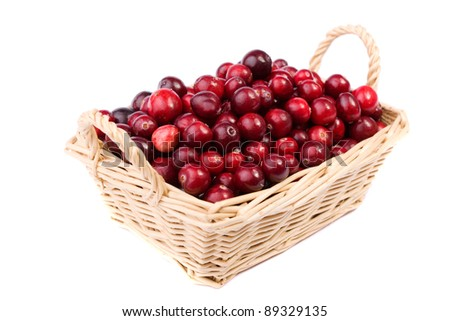 fresh cranberry in the wicker basket made in studio on white background