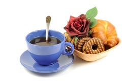 Fresh croissant and cookie with black tea on a white background