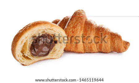 Fresh croissants with chocolate stuffing on white background. French pastry